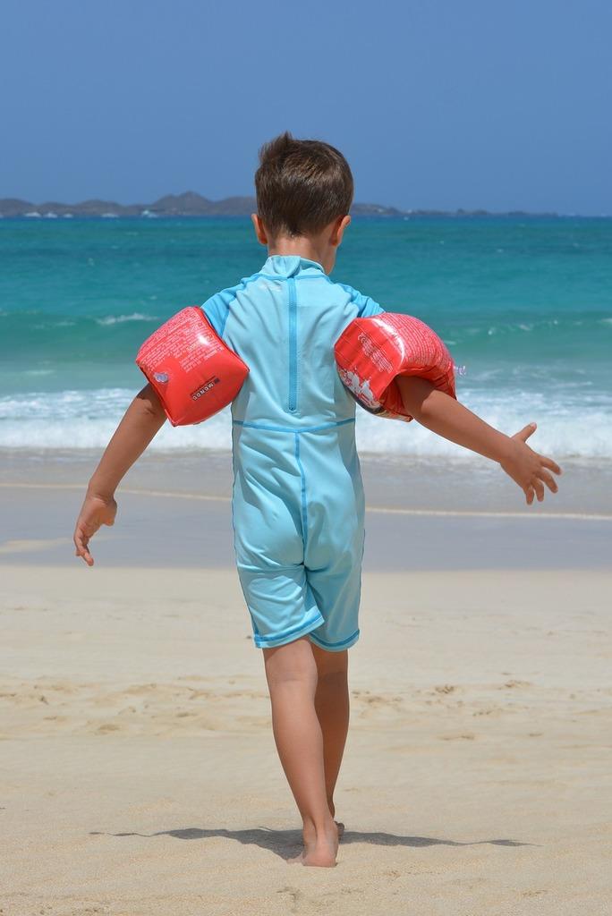 Boy beach sea, people.