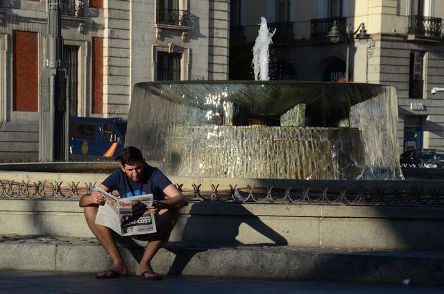 Boy reading newspaper newspaper reading.