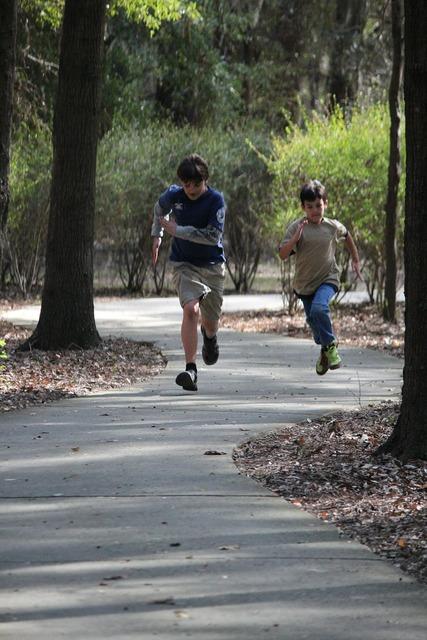 Boys running trails summer.