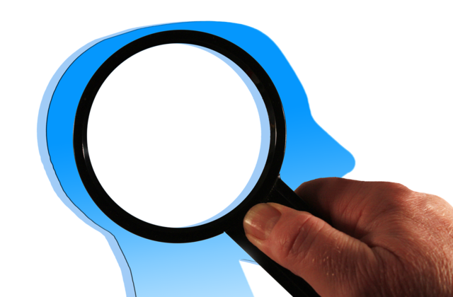 Brain head magnifying glass.