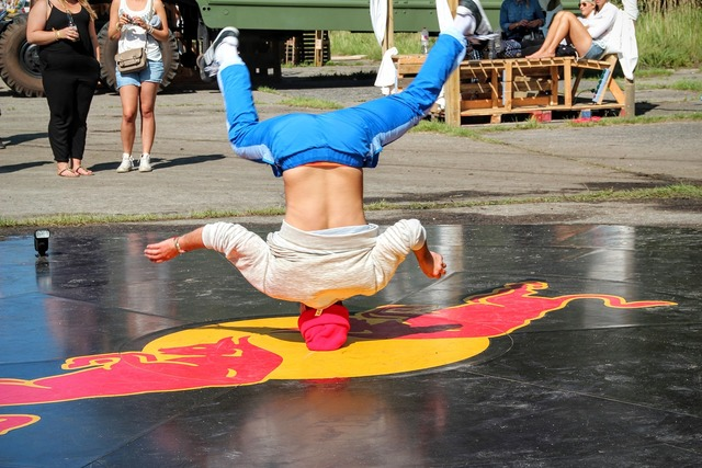 Break dancing standing on your head acrobatics.