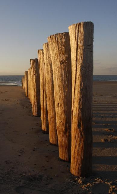 Breakwater beach north sea, travel vacation.