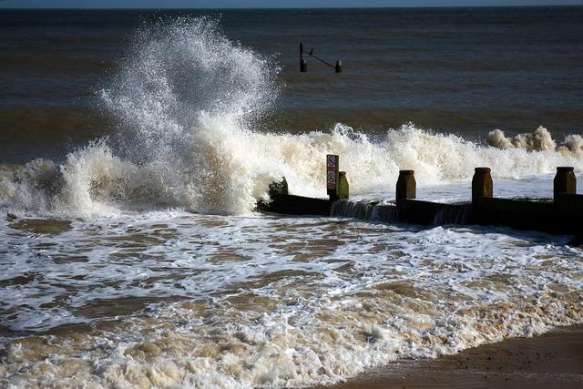 Breakwater north sea waves, travel vacation.