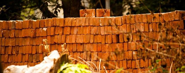 Bricks wall fabrication, architecture buildings.