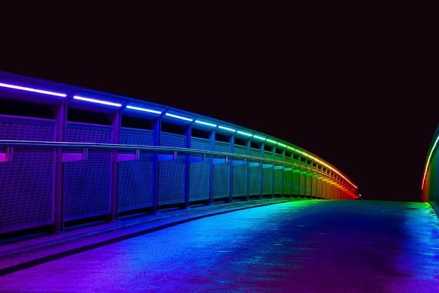 Bridge illuminated colorful, architecture buildings.