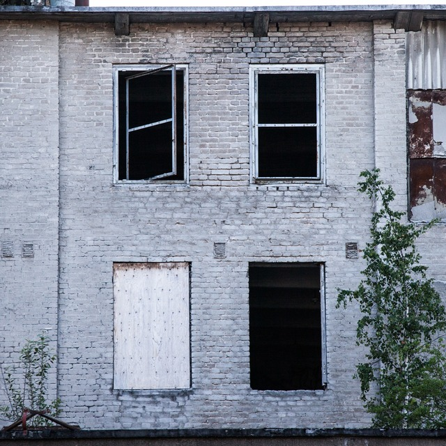 Broken windows brick wall abandoned factory, industry craft.