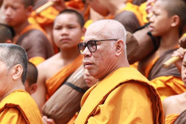 Buddhists monks sitting, people.