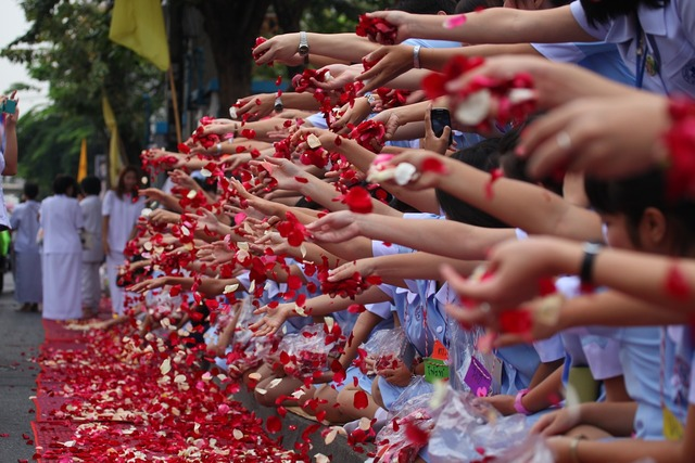 Buddhists rose petals ceremony, people.