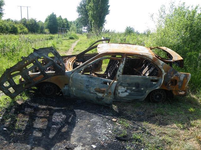 Burnt car vandalism, transportation traffic.