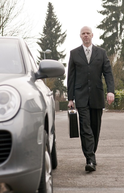 Businessman porsche luggage, transportation traffic.