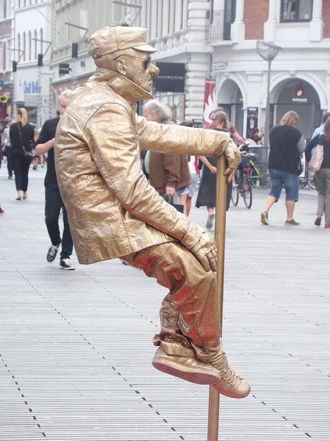 Busker busking street performer.
