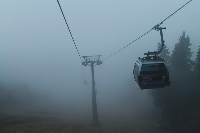 Cableway fog mountains.