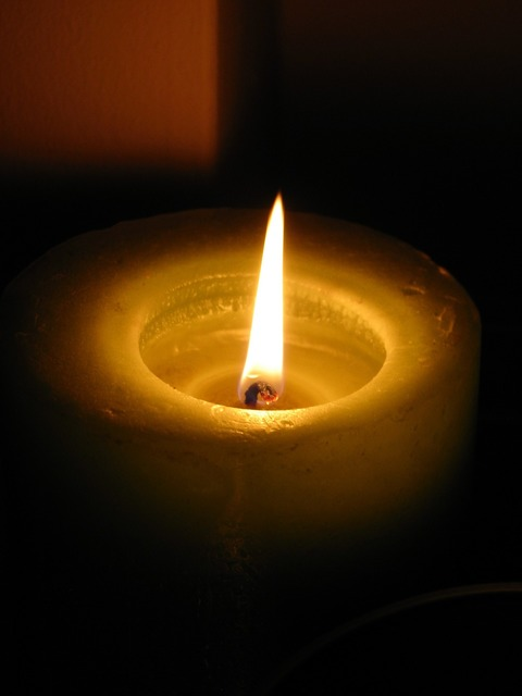 Candle dark flame.
