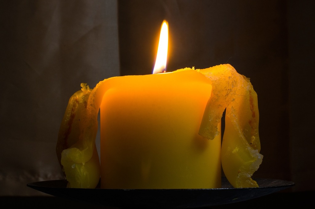 Candle flame yellow.