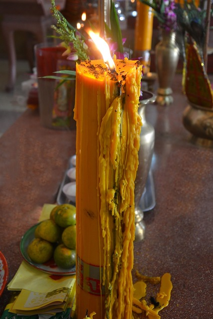 Candle yellow flame, religion.