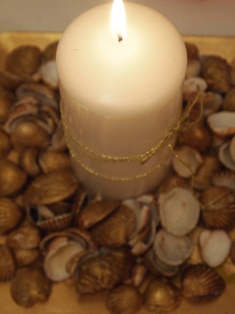 Candles lighting shells.