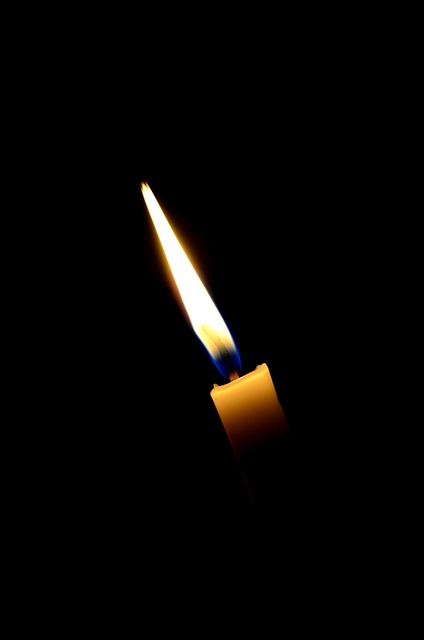 Candles lights flame.