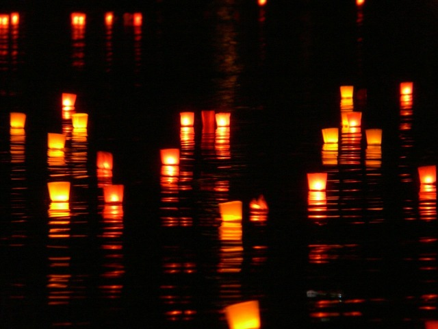 Candles lights river, emotions.