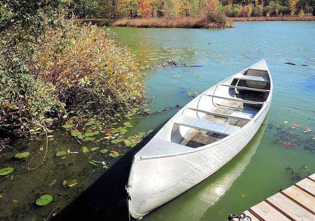 Canoe fresh water lake autumn colors.