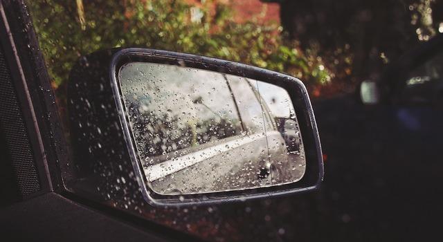 Car mirror raining rain.