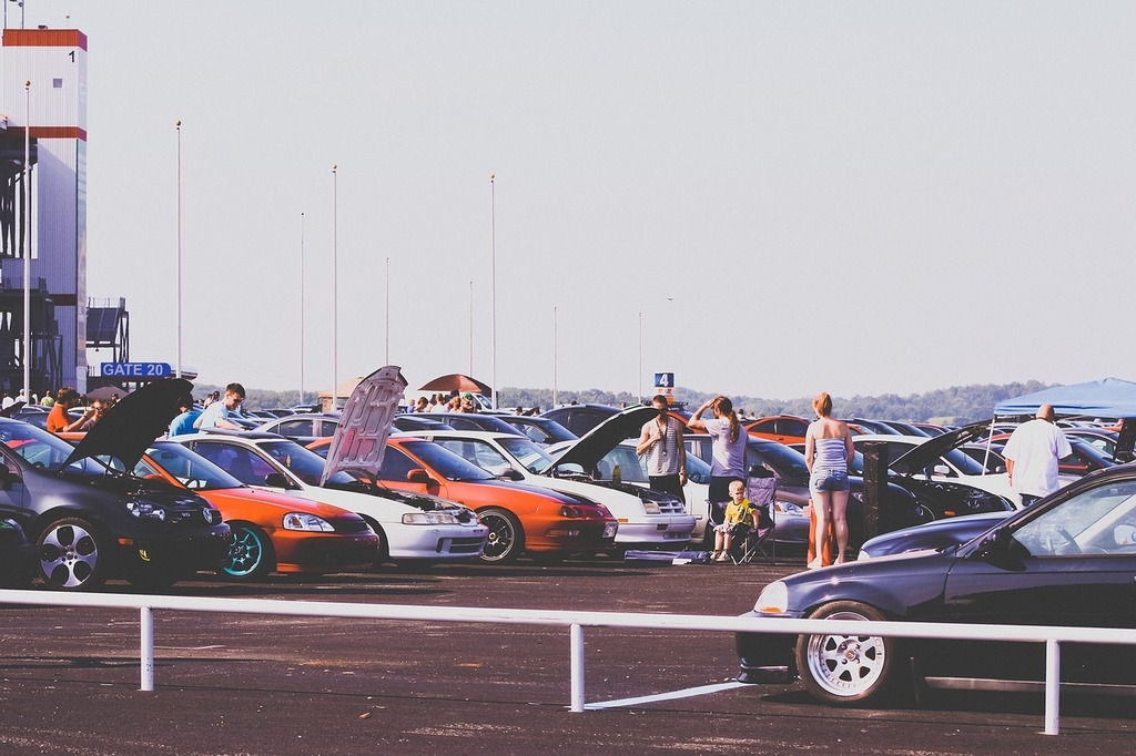 Cars car show parking lot, people.