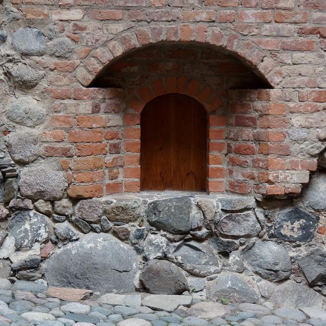 Castle door door recess brick wall.