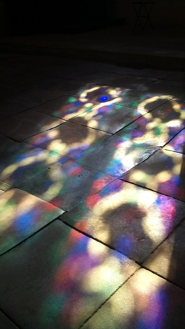 Cathedral stain glass reflection.
