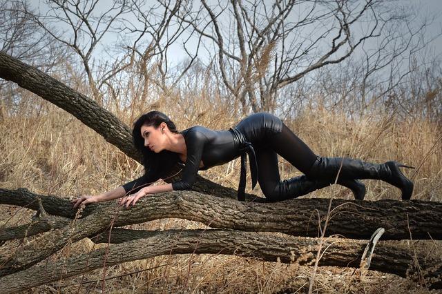 Catwoman black clothes model, nature landscapes.