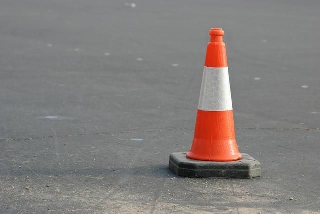Caution cone orange, transportation traffic.
