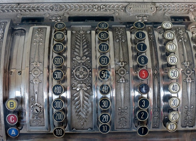 Checkout cash machines old, business finance.