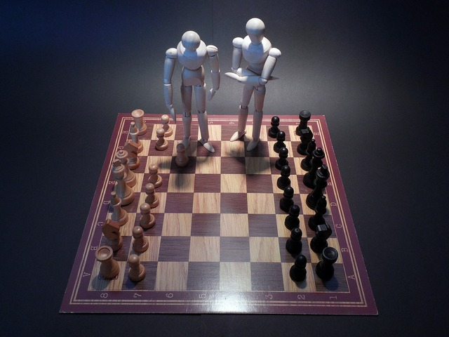 Chess board game play.