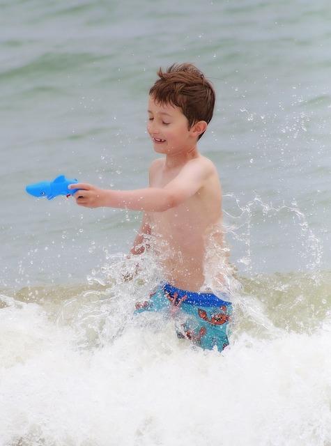 Child beach games, people.