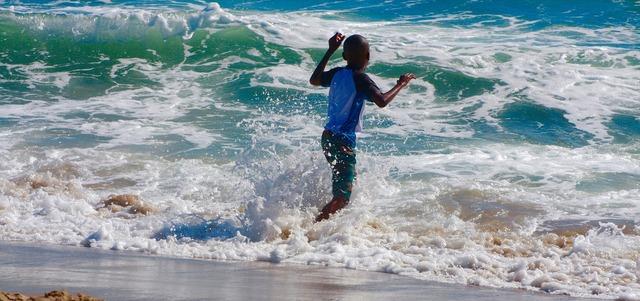 Child sea wave, people.
