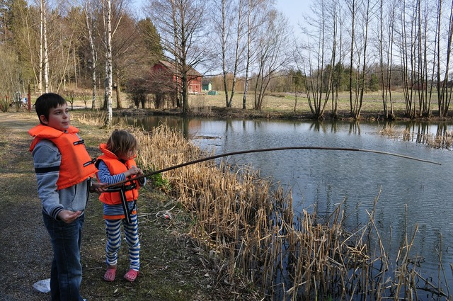 Children lake fishing.