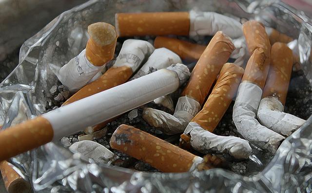 Cigarettes ash tilt.