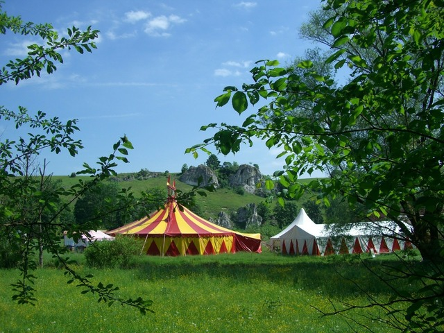 Circus tent circus in the green eselsburg valley, nature landscapes.