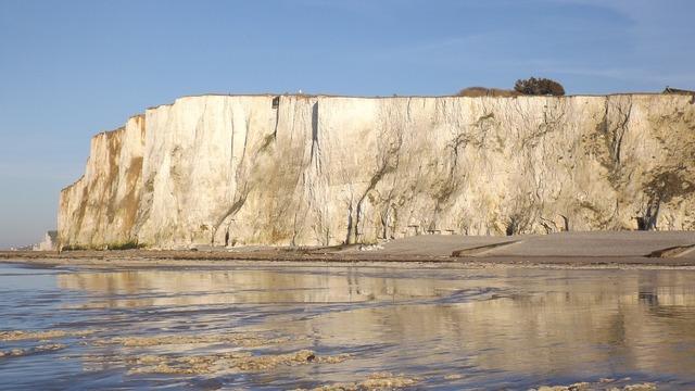 Cliff sea beach, travel vacation.