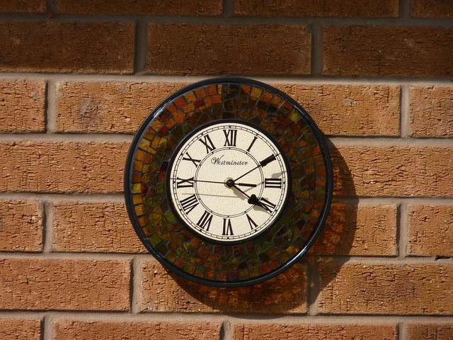 Clock wall shadow.