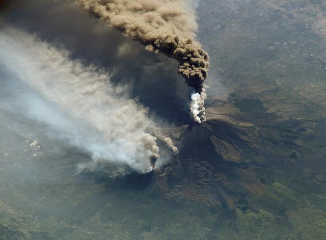 Cloud of smoke etna volcanic eruption.