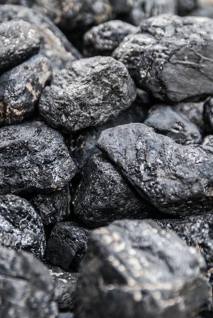 Coal briquette black.