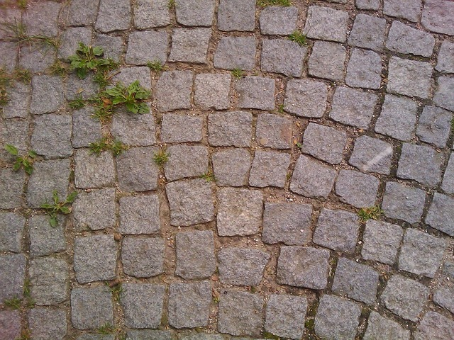 Cobblestones away road, transportation traffic.
