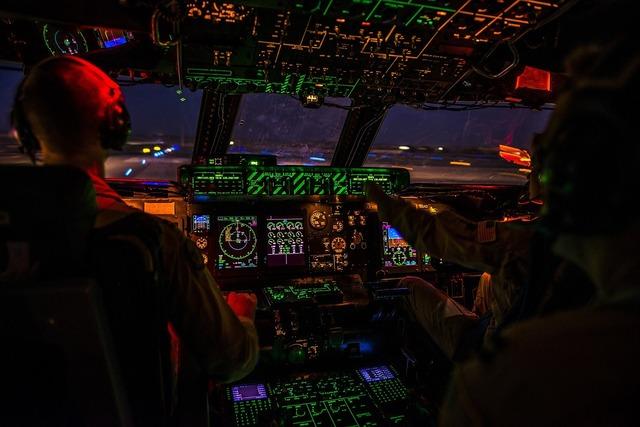 Cockpit night airplane, transportation traffic.