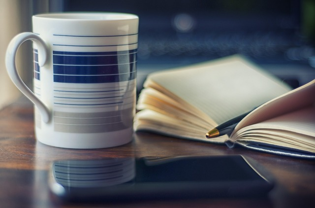 Coffee coffee mug pen, computer communication.