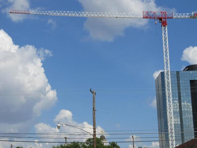 Construction crane crane telephone pole, architecture buildings.