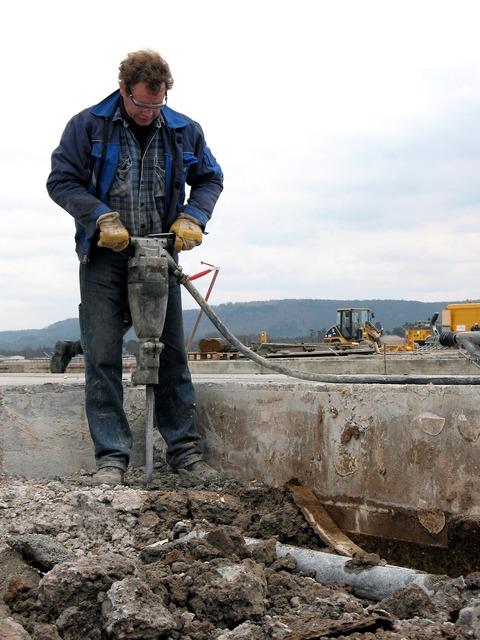 Construction jackhammer equipment, architecture buildings.
