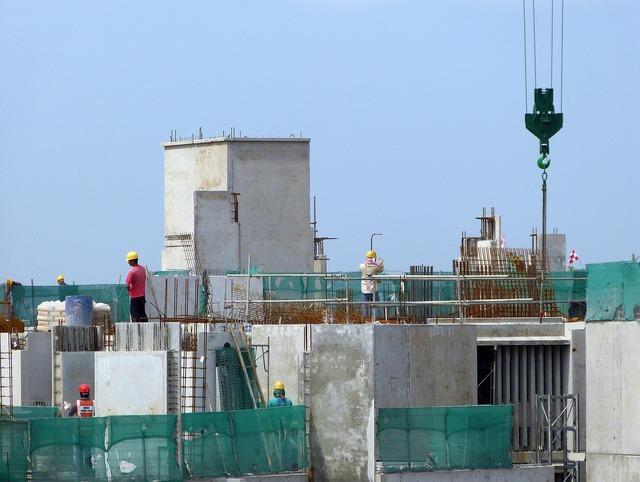 Construction site crane, architecture buildings.
