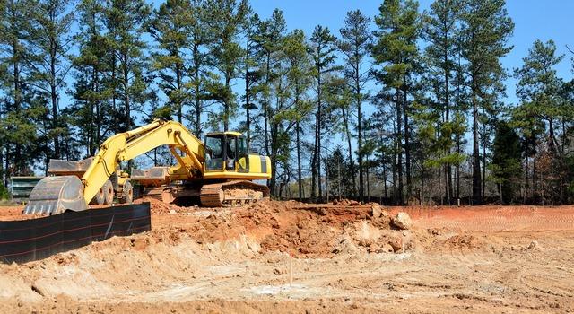 Construction site heavy equipment, architecture buildings.
