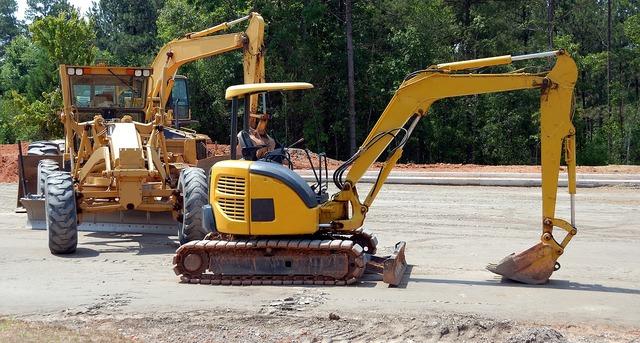 Construction site heavy equipment backhoe, industry craft.