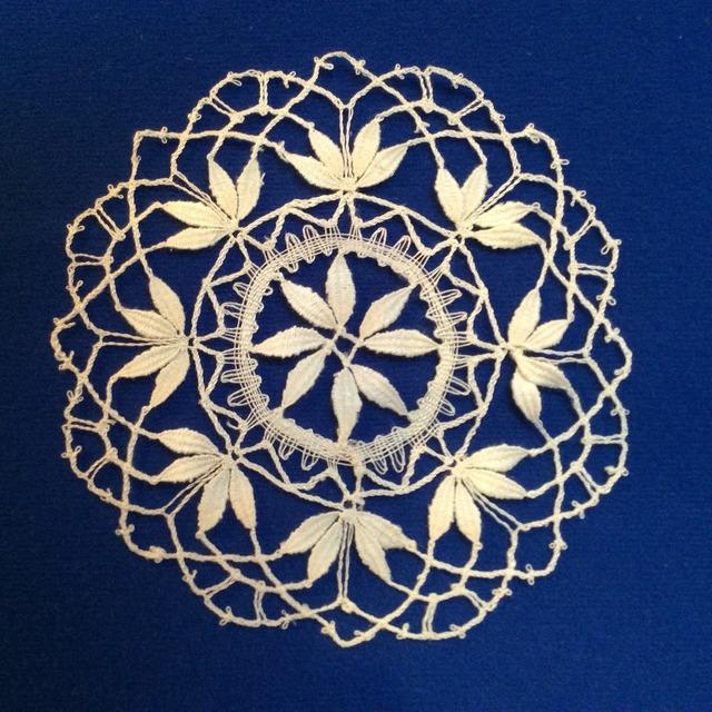 Contemporary lace cluny motif bobbin lace.