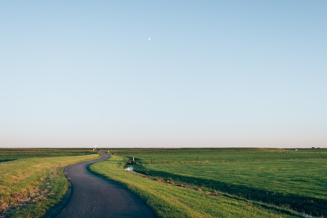 Countryside cropland farm, transportation traffic.